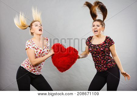 Two Agressive Women Having Argue Fight Holding Heart