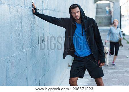 Sportsman Posing At Wall