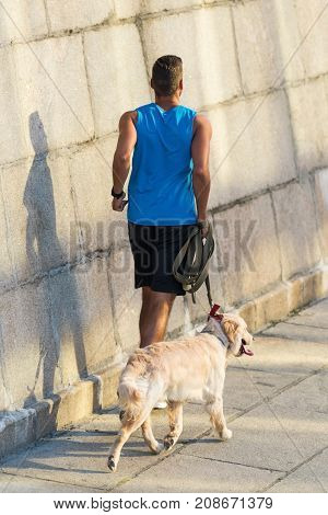 Sportsman Running With Dog
