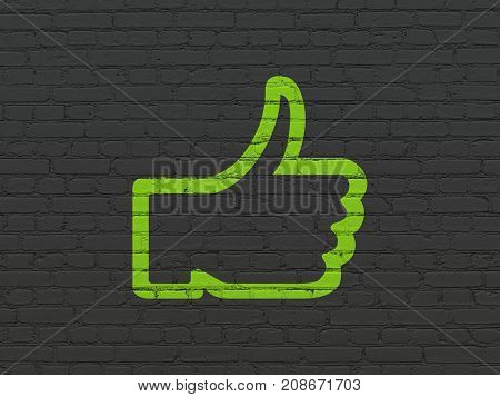 Social network concept: Painted green Thumb Up icon on Black Brick wall background