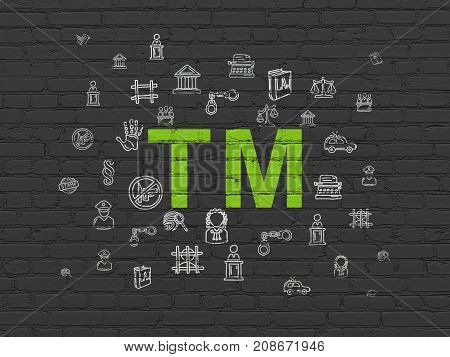 Law concept: Painted green Trademark icon on Black Brick wall background with  Hand Drawn Law Icons
