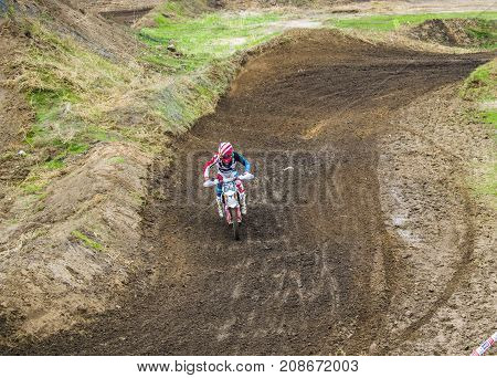 Extreme Sport. A Rider On A Motorcycle Rides The Sand.