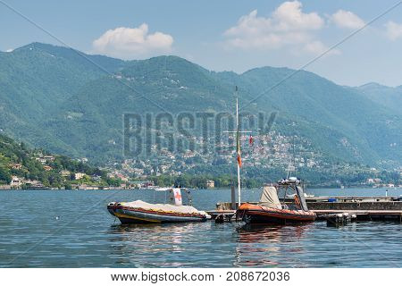 Como Italy - May 27 2016: Moored rescue boats on Como lake in Como City Italy.
