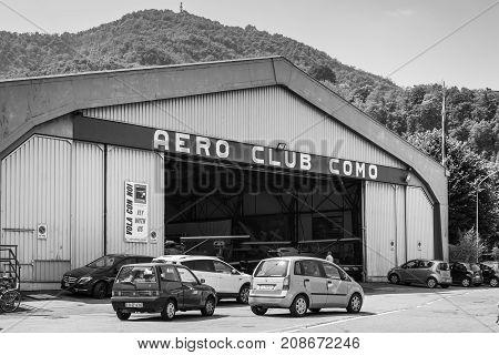 Como Italy - May 27 2016: Hangar of the Aero Club Como at water aerodrome of Como lake in Como City Italy. Black and white photography.