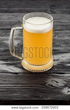 Beer Mug On A Dark Wooden Table