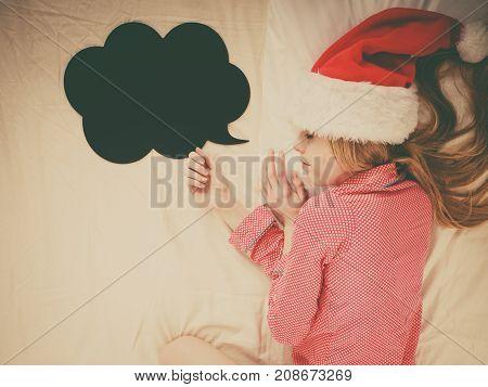 Sleeping Woman Wearing Pajamas And Santa Claus Hat