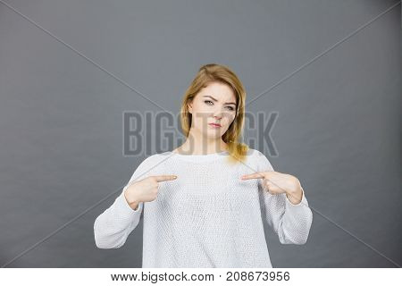 Confused Woman Pointing At Herself