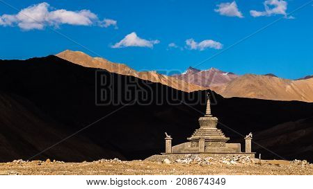 stupa with contrast shade shadow mountain and blue sky background in leh ladakh india