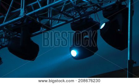 strobe lights emitting different color beams hanging under the ceiling.