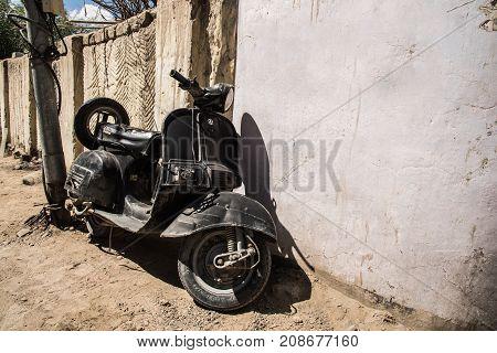 Leh LadakhIndia - 2017 September 22 : old scooter vespa parking at the wall in leh city india
