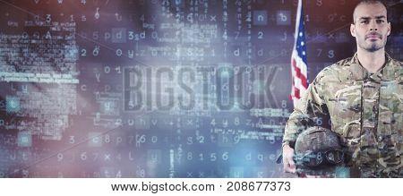 Portrait of confident soldier standing with combat helmet against dark room