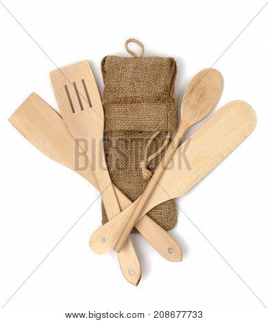 Wooden kitchen cutlery isolated on white background