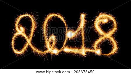 Happy New Year - 2018 with sparklers on black background