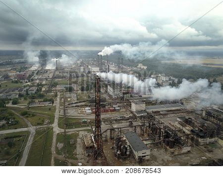 Factory smoke stack - Oil refinery petrochemical or chemical plant. View from the height