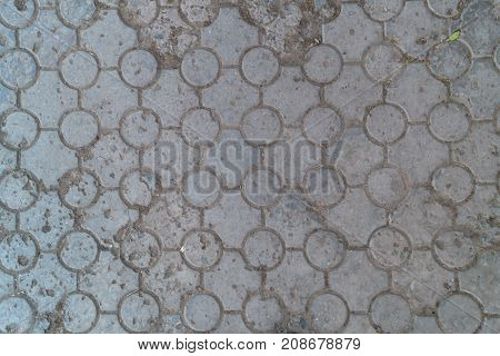 Grey round tile on the sidewalk background texture