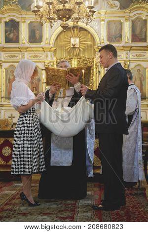 LUTSK UKRAINE - 26 March 2017: The ceremony of christening the little girl at church