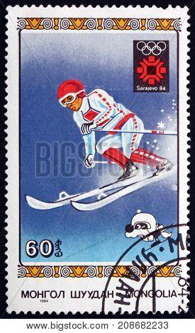 MONGOLIA - CIRCA 1984: a stamp printed in Mongolia shows Downhill Skiing 1984 Winter Olympics Sarajevo circa 1984