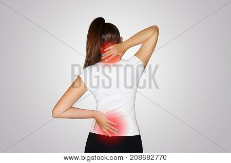 Pain In The Neck And Back. A Young Woman Suffers From Pain In The Neck And Back. Spine Osteoporosis.