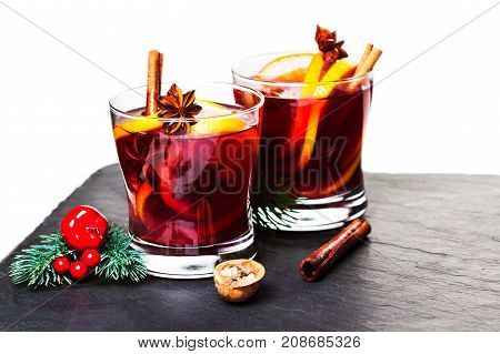 Mulled wine on black slate board isolated on white background cwith copyspace