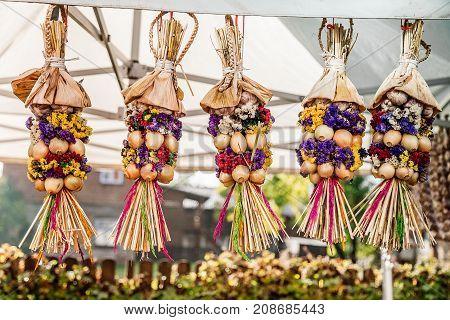 A bundle of onions and garlic at the fair in KuldigaLatvia