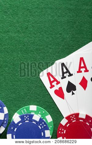 Playing Cards, Poker Chips On Green Table