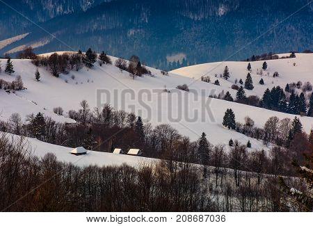 Village On Snowy Hill In Winter
