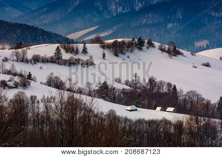 Village On Snowy Hill In Winter