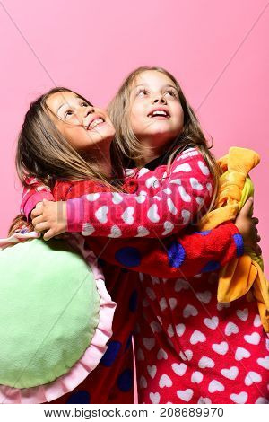 Pajama Party And Childhood Concept. Girls With Loose Hair Hug
