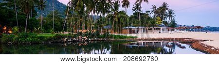 Ko Samui Thailand. Summer resort at Ko Samui Thailand. Little bungalow hidden in the trees with water at sunset
