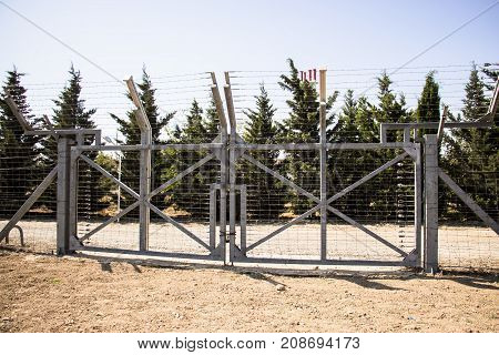 Electronic gates with motion sensors guarding the fence