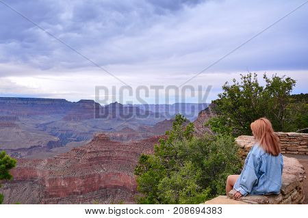 Beautiful woman looking out at the Grand Canyon from the South Rim Usa.