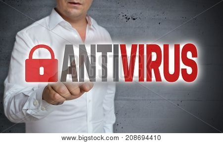 Antivirus touchscreen is operated by man picture