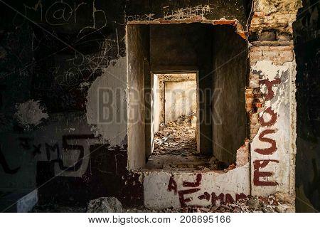 Door through the door in a house in ruins