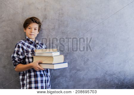 Cute Teenage School Boy Holding Books