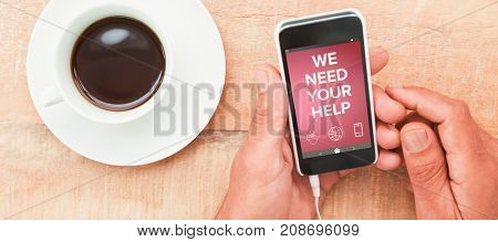 Digitally composite image of We Need your Help text with various icons  against hands holding smartphone next to cup of coffee