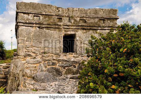 A Mayan ruin against a blue sky
