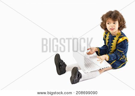A Picture Of A Young Caucasian Boy In Shock/exasperation Sitting With A Laptop. He Is Dressed As A K