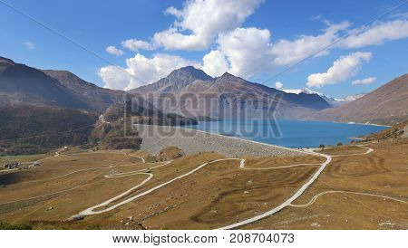 Savoy Autumn landscape. French hydropower: dam in the mountains. French Alps the Lake of the Mont-Cenis pass