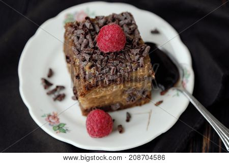 Delicious chocolate cake with raspberries on the table