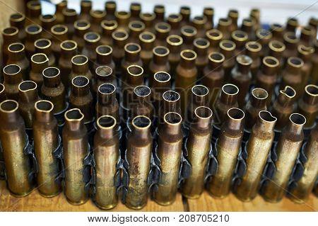 Brass Cases Of Cartridges In Machine-gun Tape