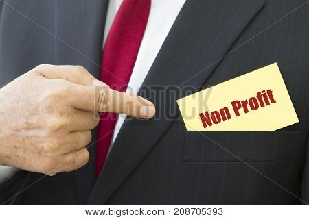 Businessman showing a card with text NON PROFIT.