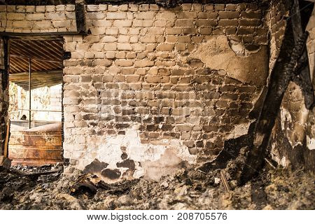 details of the burnt house in the country .