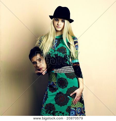 Young attractive couple. Handsome man and sexy woman. Absurd photo