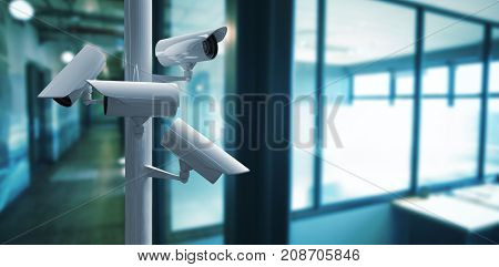 CCTV camera against view of office corridor and workspace