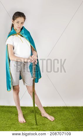 Young Woman In A Cape With A Samurai Sword