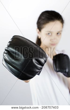 Young Woman With Boxing Gloves. Selective Focus. Protection Concept