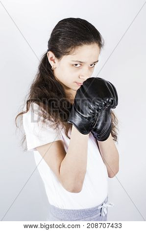 A Teenager In Sports Uniform Is Boxing. Protection Concept