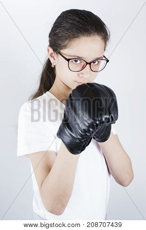A Teenager In Sports Uniform And Glasses Is Boxing. Protection Concept
