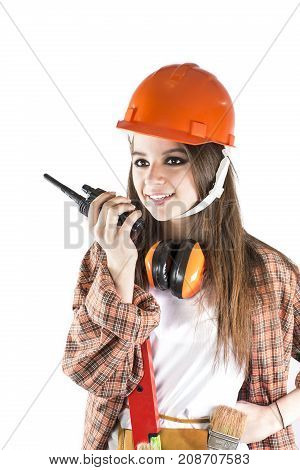 Beautiful girl in a helmet. Woman using Walkie Talkie