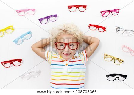 Child At Eye Sight Test. Kid At Optitian. Eyewear For Kids.